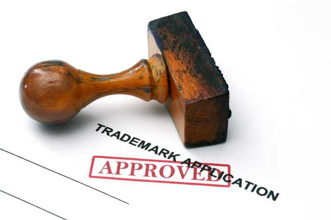 Wooden Trade Mark Hand Stamp On Trademark Application Form Stamped Approved